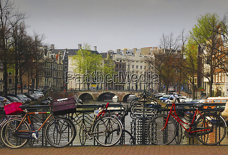 amsterdam bicycles on bridge over canal