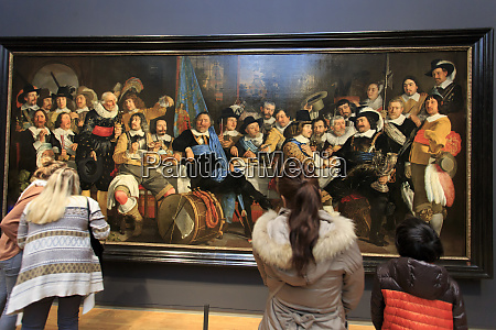 visitors enjoying the artwork at the