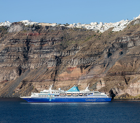 cruise ship anchored under fira village