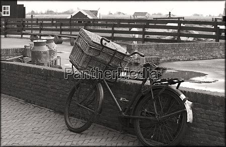 an old fashioned bike with basket