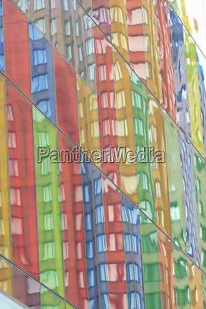 building reflecting in colorful windows of