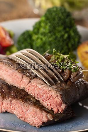 halves of a steak on a