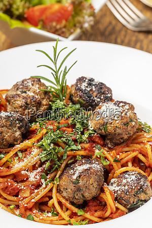 spaghetti with meat balls on dark