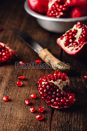 pomegranate fruits with knife