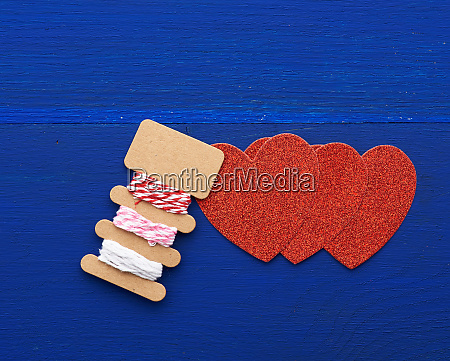 paper red shiny decorative hearts on