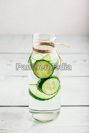 infusion with sliced cucumber in bottle