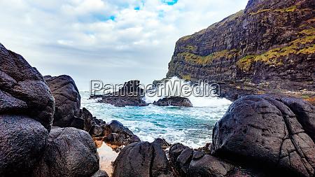 waves crashing on cliff near dunluce