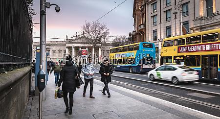 people walking down a shopping street