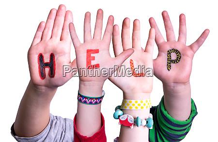 children hands building word help isolated