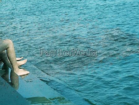 water flow splash and woman legs