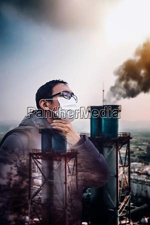 man wearing mask against smog