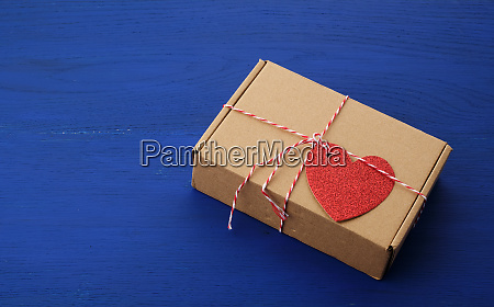 rectangular brown box with a gift
