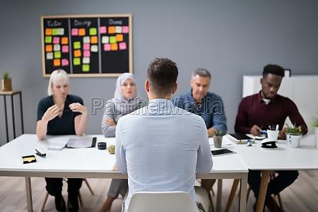 man sitting at interview