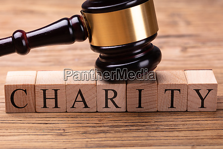 gavel over wooden blocks with text