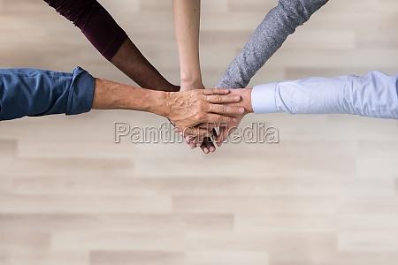 stacked hands symbolizing team effort