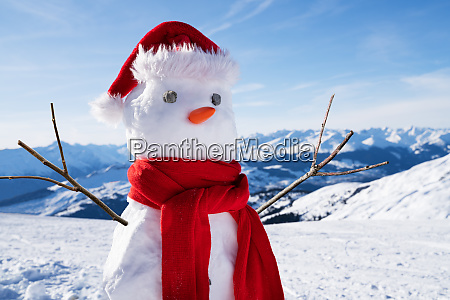 incomplete snowman with hat and scarf