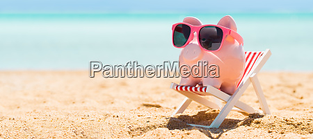 pink, piggybank, on, deck, chair, over - 27948554
