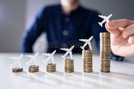 human hand placing small airplane on