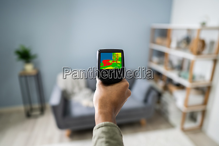 person hand using infrared thermal camera