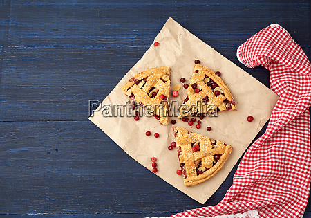 triangular slices of baked cranberry pie