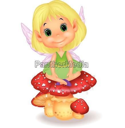 cute fairy sitting on mushroom