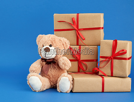 beige teddy bear and a stack