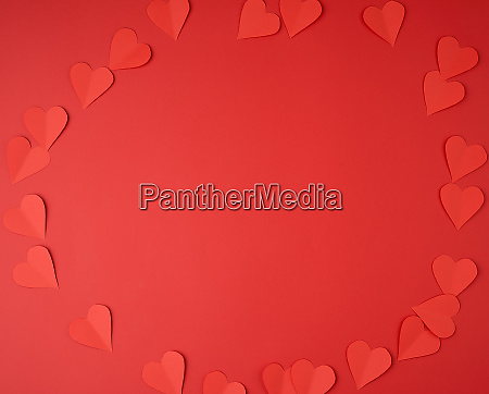 hearts cut out of red paper