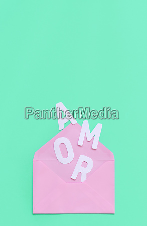 pink envelope and text amor on