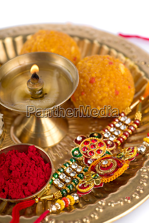 indian festival rakhi with rice grains