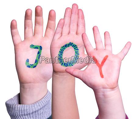 children hands building word joy isolated