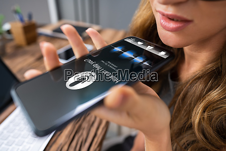 woman using voice assistant on cellphone