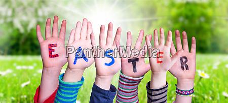 children hands building word easter grass