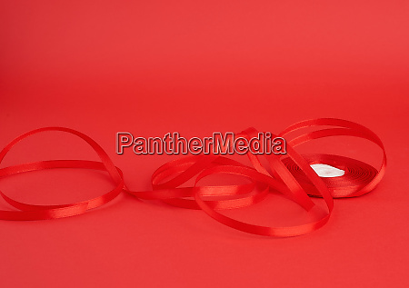 twisted red silk shiny ribbon on