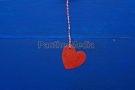 paper red shiny decorative hearts hanging