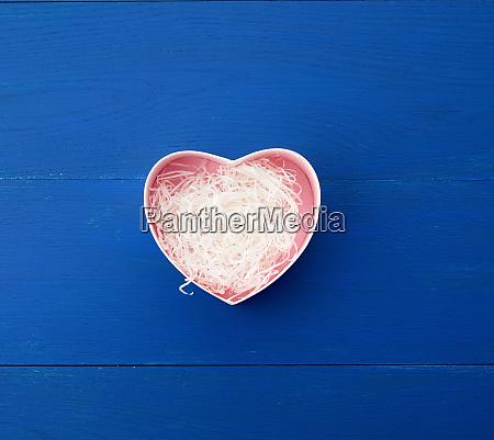 open empty heart shaped box on