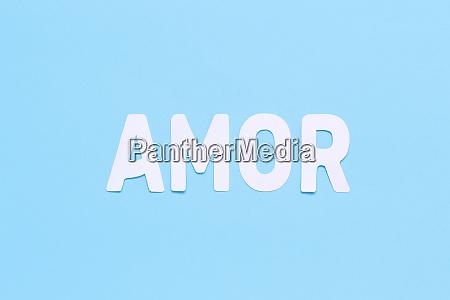 word amor on a light blue