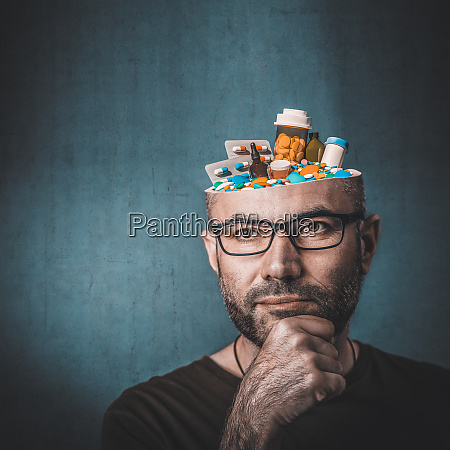 portrait of man with pills in