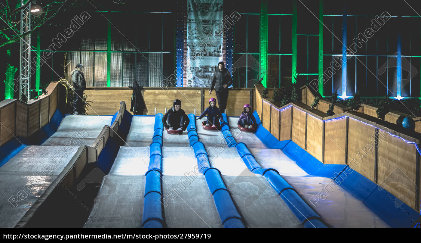 children, and, adults, tobogganing, on, an - 27959719