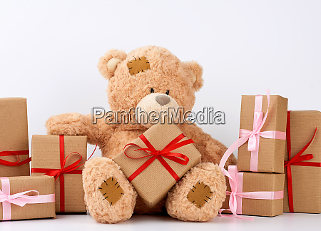 big beige teddy bear with patches