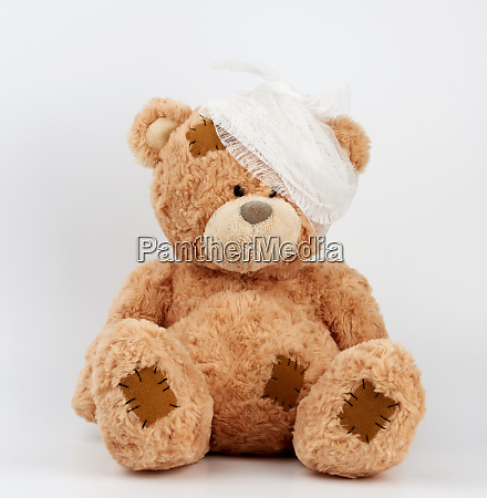 big teddy bear with a bandaged