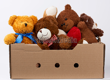 brown cardboard box with various teddy