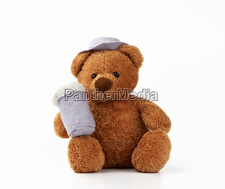 cute little brown teddy bear holds