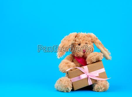 cute little brown plush rabbit