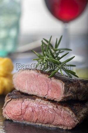 slices of grilled steak on black