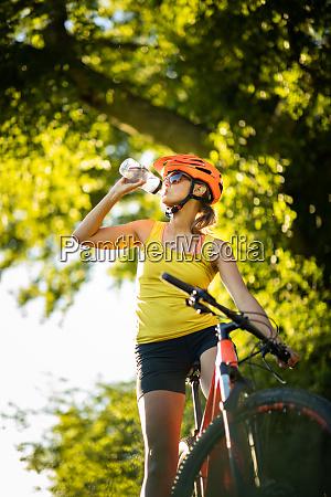 pretty young woman biking on a