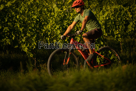 handsome young man biking on a