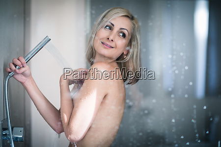 woman taking a long hot shower