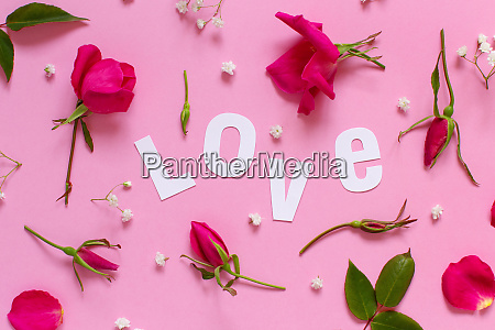 pink roses and text love on