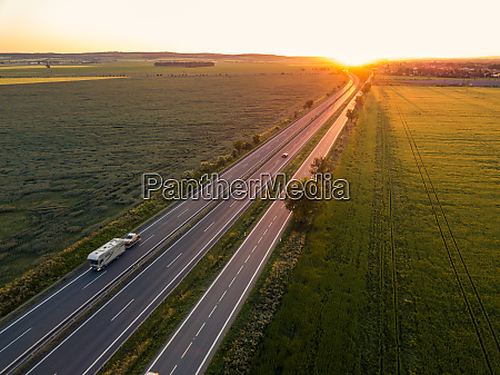 cars on the road at sunset