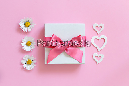 white gift box daisies and hearts